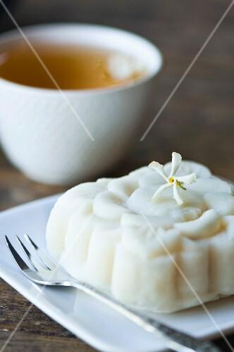 A rice cake and a cup of jasmine tea
