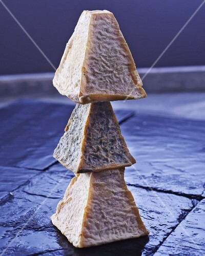 A stack of three goat's cheeses
