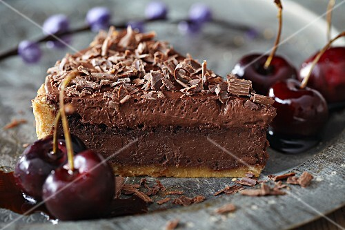 A slice of chocolate tart with cherries