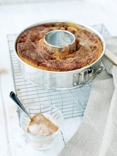 A Bundt cake with cinnamon sugar in a baking tin