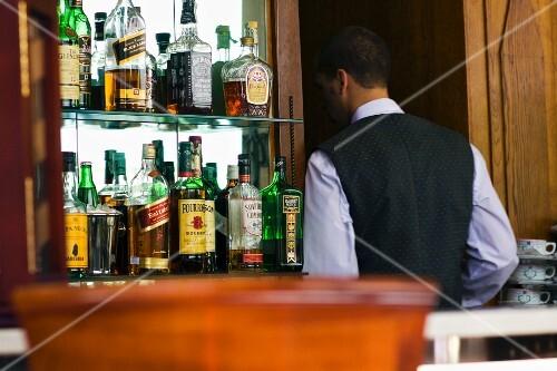 a waiter at the bar