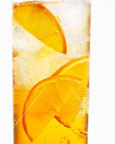 A glass of Aperol with orange slices (close-up)