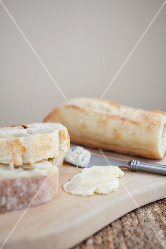 Ciabatta and butter on a chopping board