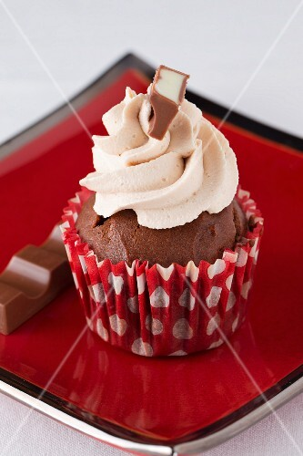 A chocolate cupcake and chocolate bar