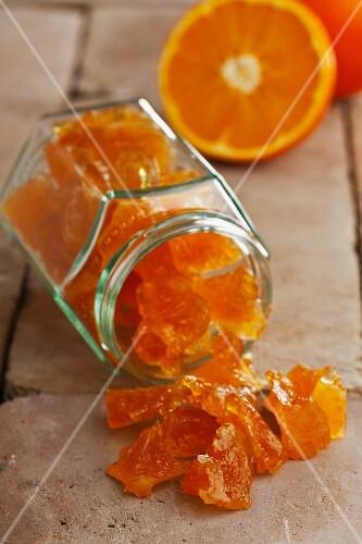 Candied orange pieces in a jar