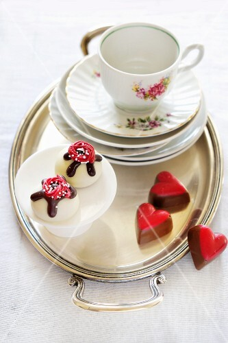 Various pralines and old-fashioned coffee crockery