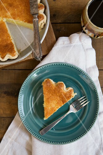 Slice of Buttermilk Pie on Blue Plate, High Angle View