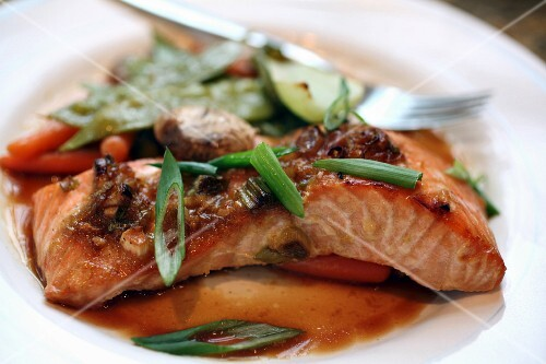 Asian-marinated salmon with steamed vegeatables and chopped scallion garnish