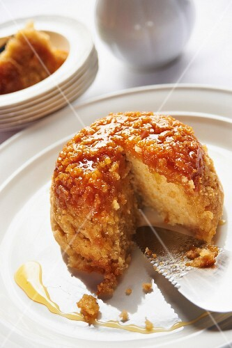 A steamed syrup pudding, sliced