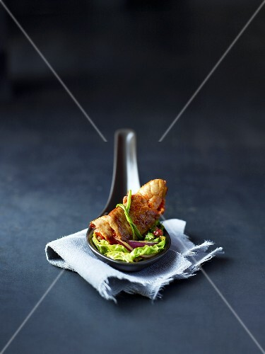 Beef roulade with a savoy cabbage leaf on a spoon