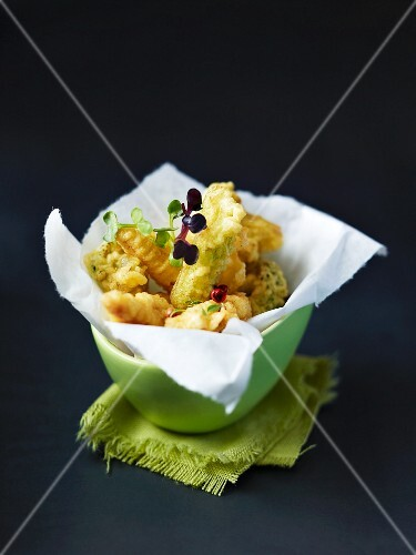 A bowl of tempura with cress
