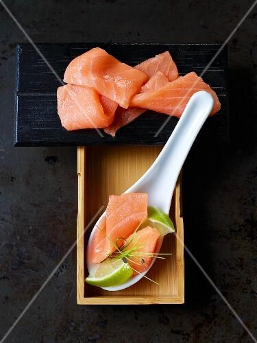 Salmon sashimi with limes (Japan)