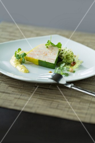 A slice of terrine with a side salad