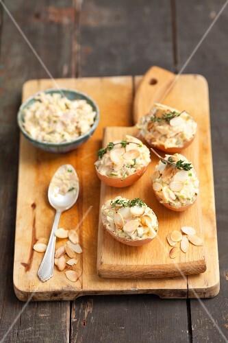 Egg salad with slivered almonds served in eggshells