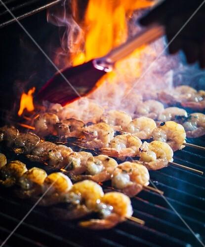 Prawn kebabs on a smoking barbecue