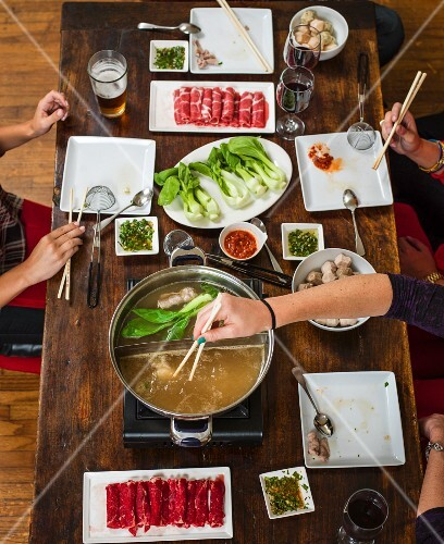 Hotpot made with beef, pork, bok choy and meatballs (China)