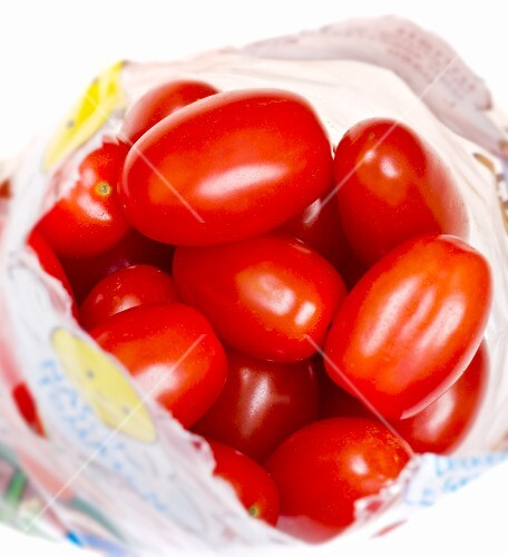 A bag of cocktail tomatoes (close-up)