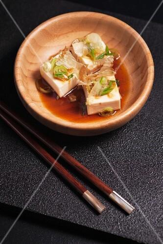 Hiyayakko (cold silk tofu, Japan) with bonito flakes, chives, grated ginger and soy sauce