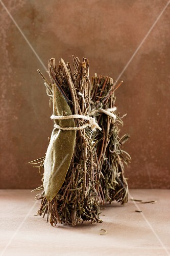 Dried bunches of herbs with thyme, bay leaves, rosemary and oregano