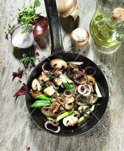 Fried mushrooms with red onions, spring onions, thyme marjoram and olive oil