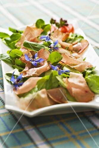 Styrian Vulcano ham on a bed of lamb's lettuce with balsamic vinegar