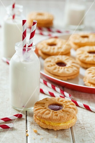 Jam and custard cream biscuits and a small bottle of milk