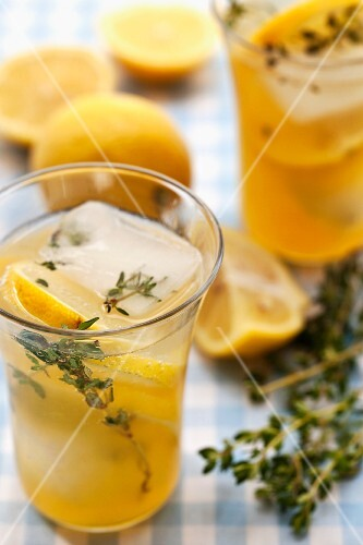 Homemade lemonade with thyme, lemon and ice cubes