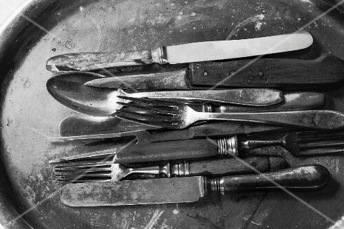 Knives and forks on a vintage tray