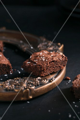 Brownies with dessicated coconut on and in a picture frame