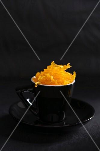 A cup of organic spirelli made form corn flour (gluten free)