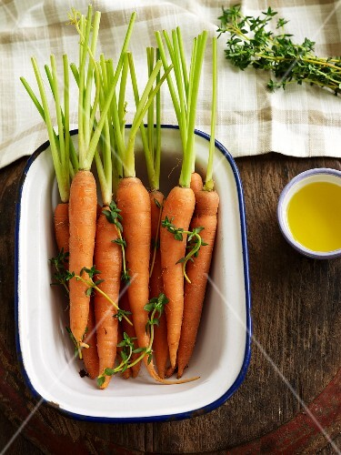 Fresh carrots, thyme and olive oil