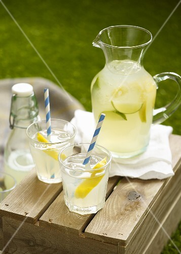 Lemonade on a wooden box in a garden