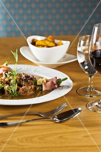 Mountain lamb ragout with bacon beans and rosemary potatoes (East Tyrol, Austria)