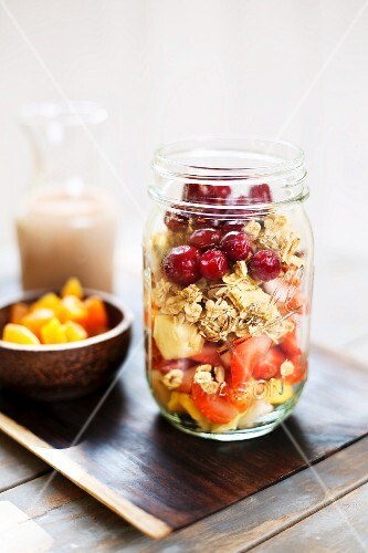Fruit muesli, dried apricots and almond milk