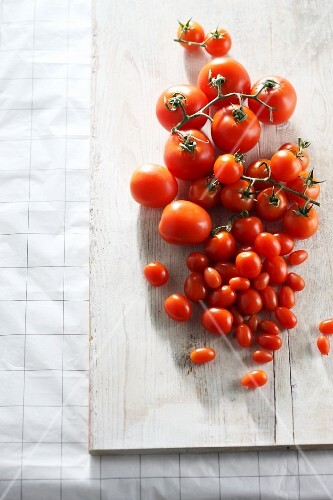 Various tomatoes on wooden board