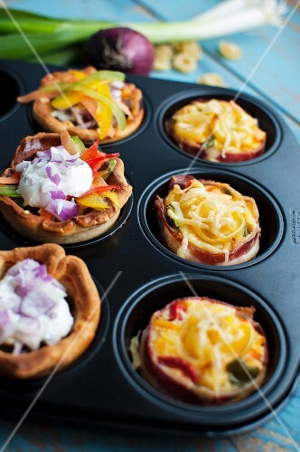 Various party snacks in a muffin tin