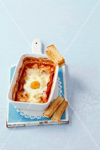 Baked egg with ham, tomato and mozzarella
