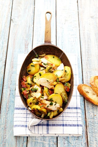 A farmer's breakfast with potatoes, chicken and bacon