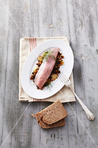 Soused herring on a bed of lentils