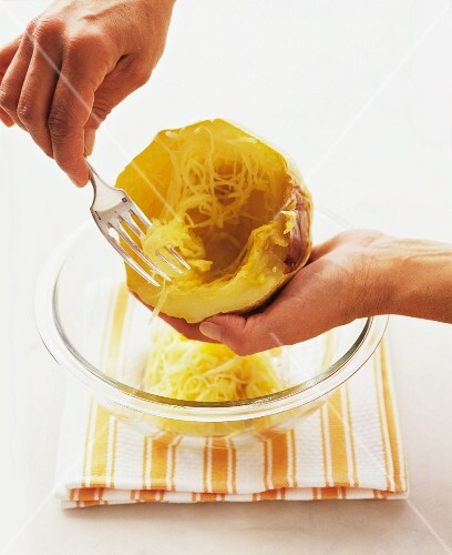 Flesh being scraped out of a spaghetti squash