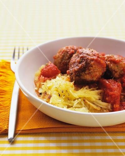 Chicken meatballs in tomato sauce on pumpkin spaghetti