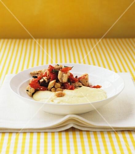 Mediterranean chicken stew with creamy polenta