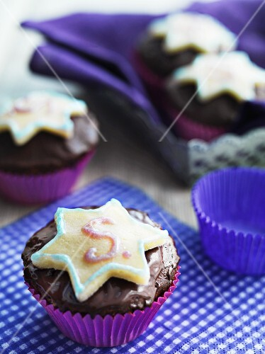 Chocolate cupcakes decorated with star-shaped biscuits