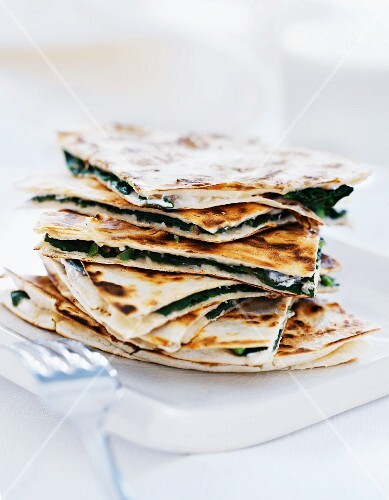 Pizza sandwiches with spinach and cheese