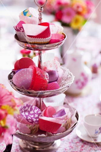 Pink paper cases for cupcakes on a cake stand