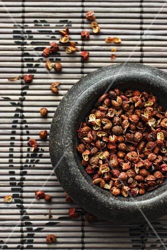Szechuan pepper in a mortar