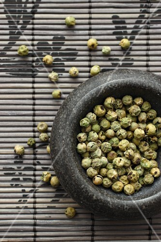Green peppercorns in a mortar