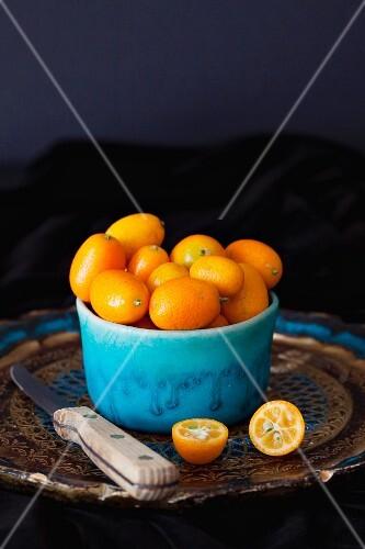 Kumquats in blue ceramic bowl