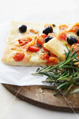 Salmon, cherry tomato and olive pizza