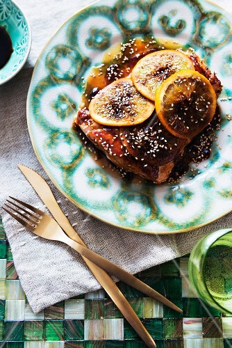 Marinated salmon fillets with soy sauce and oranges